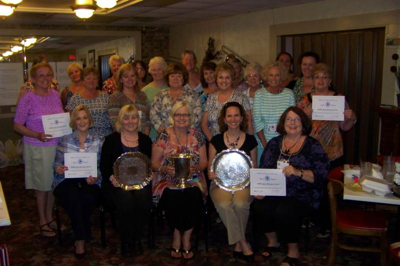 Club members proudly displaying the Silver and Certificates we won from GFWC-NC.