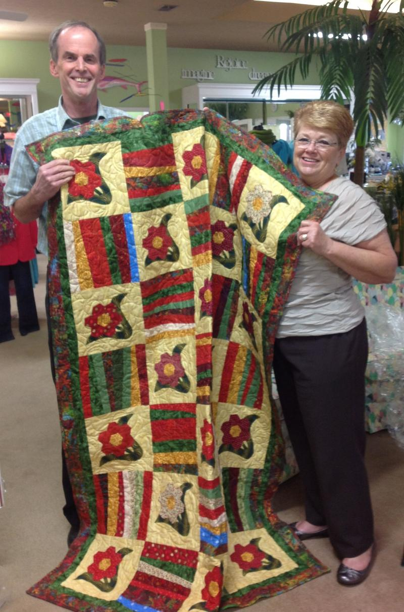 GFWC-SBI Club member Peggy Truesdale presents Quilt to Randy Weddle of Calabash!